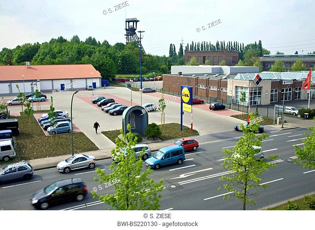 new commercial area in Bochum-Wattenscheid with the shaft tower of the former coal mine Holland in the background, Germany, North Rhine-Westphalia, Ruhr Area