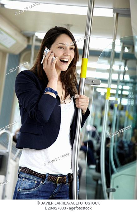 Young woman in tram, Vitoria, Alava, Basque Country, Spain