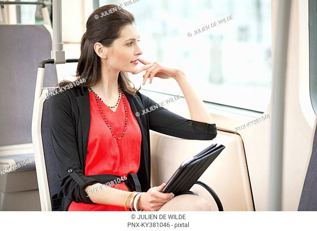 Woman traveling in a bus and thinking