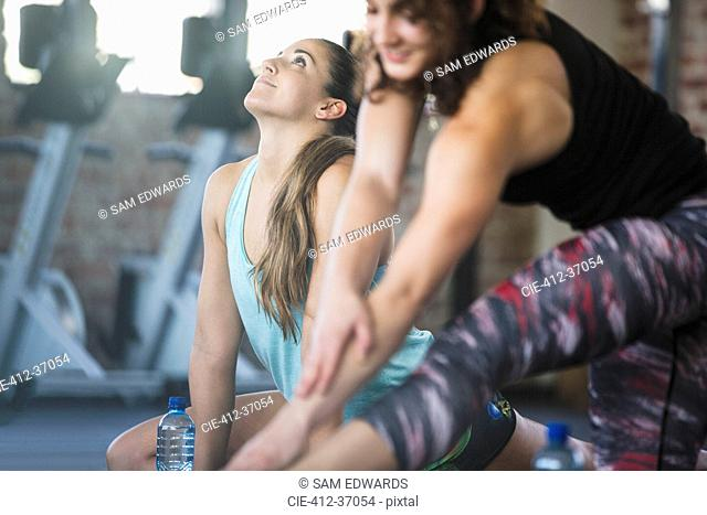 Young women stretching in exercise class at gym