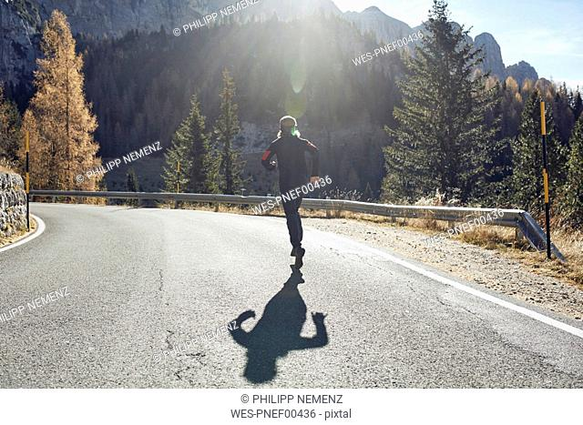 Man running on mountain road