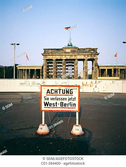 Warning sign in front of Berlin Wall and Brandenburg Gate, 1986. Berlin. Germany