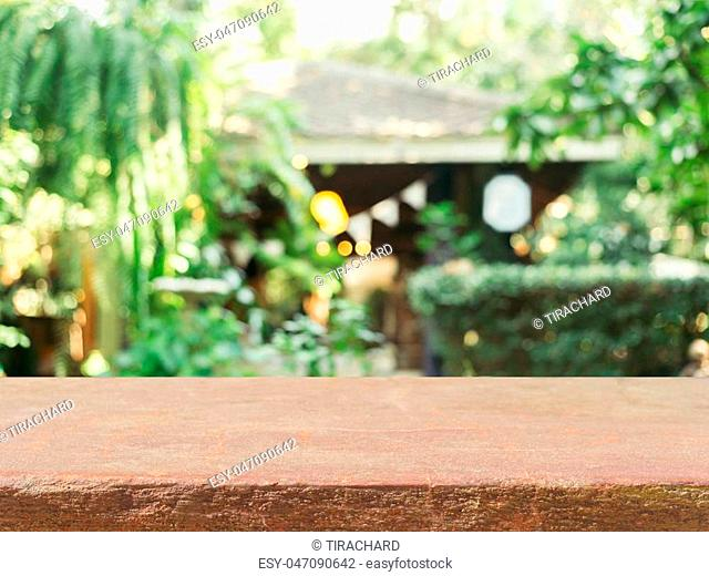 Stone board empty table in front of blurred background. Perspective brown stone over blur in coffee shop - can be used for display or montage mock up your...