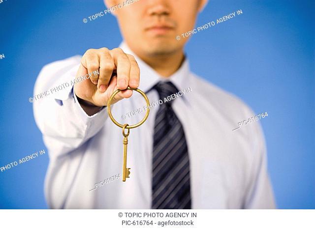 Businessman Holding Golden Key,Korean