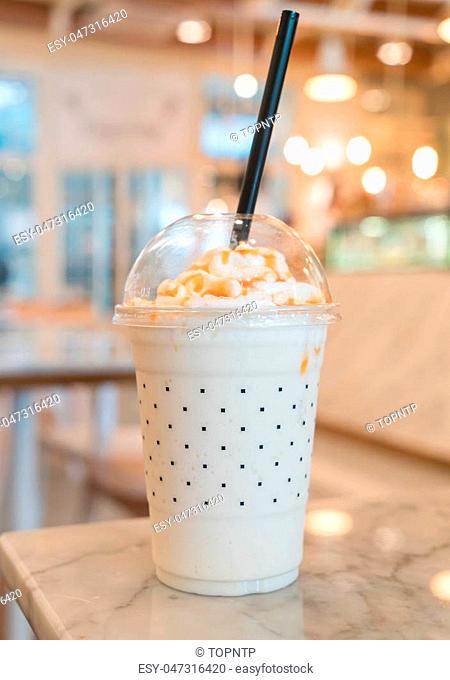 caramel milkshake on the table in cafe