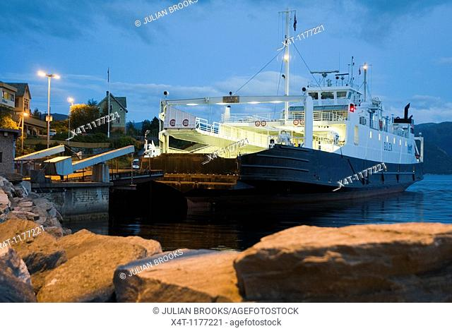 Ferry at night on the busy E39 in Norway  Waiting to take passengers over a fjord from Lavik