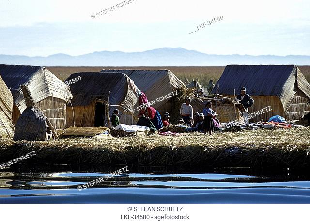 People on swimming Uro reed island, Puno, Lake Titicaca, Peru, South America, America