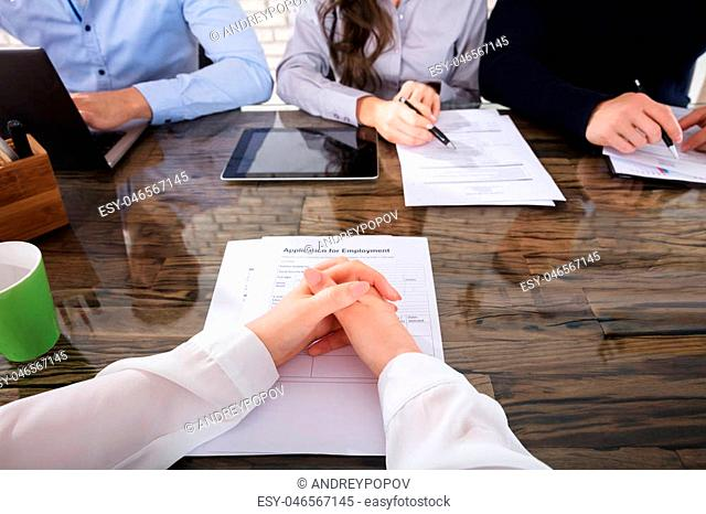 Applicant In Front Of Corporate Recruitment Officers For Interview In Office