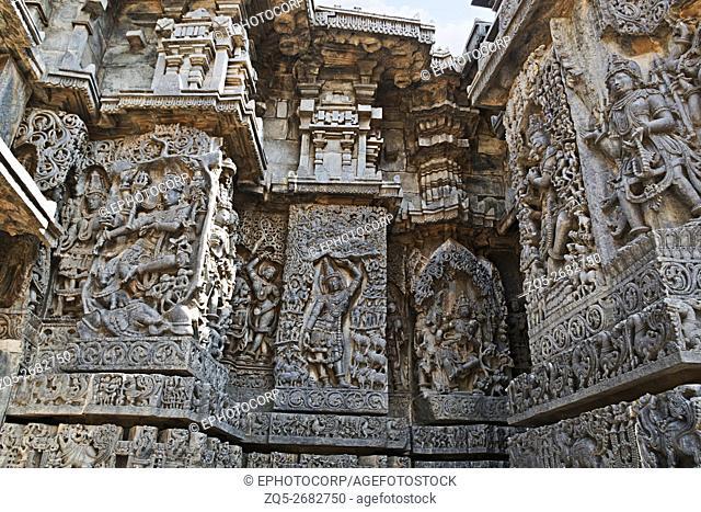 Ornate wall panel reliefs depicting Hindu deities, west side, Hoysaleshwara temple, Halebidu, Karnataka, india