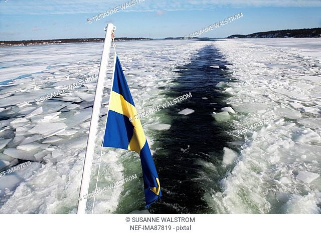 Swedish flag on boat in frozen sea