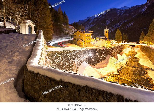 A snowy view of Campodolcino village from Ponte Romano at dusk, Spluga valley, Sondrio province, Lombardy, Italy, Europe