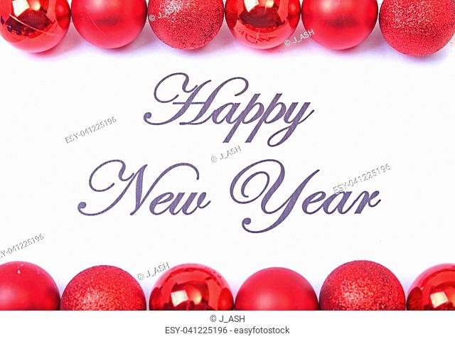 Text happy new year on paper with many balls