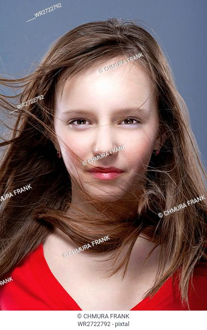 studio shot of an eleven years old girl posing as a fashion model