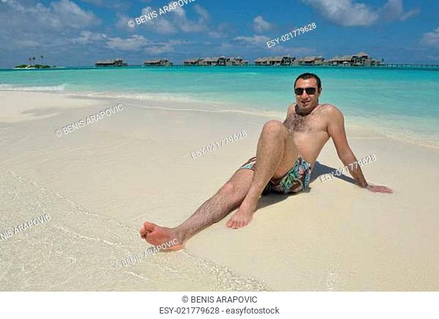young man have fun and relax on beach