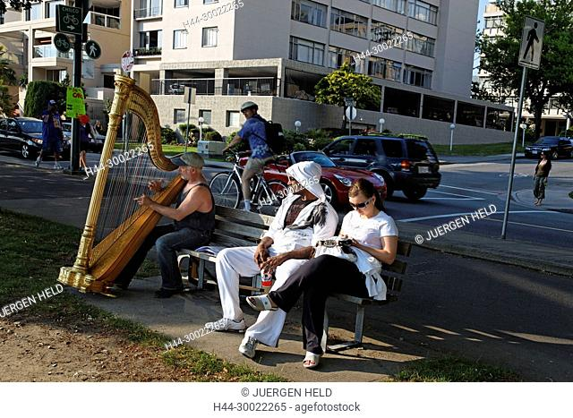 English bay , Westend, Man with harp outdoors, young people , Vancouver City , Canada, North America