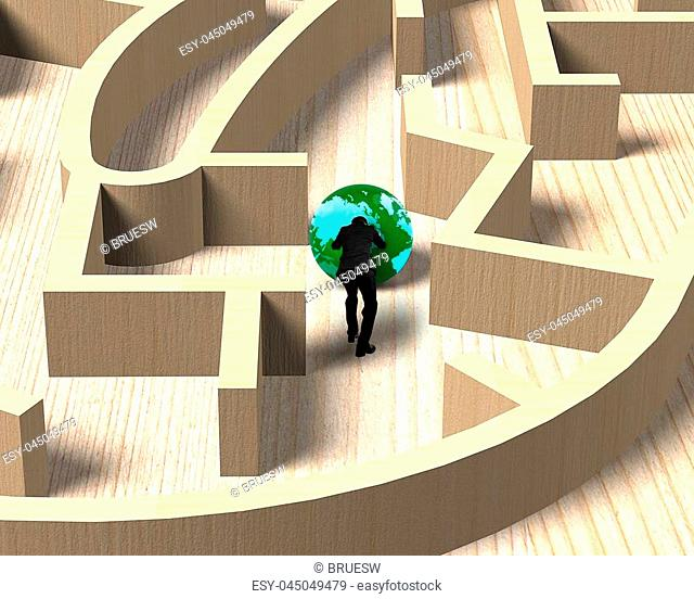 Businessman pushing green globe in the wooden maze game, rear view