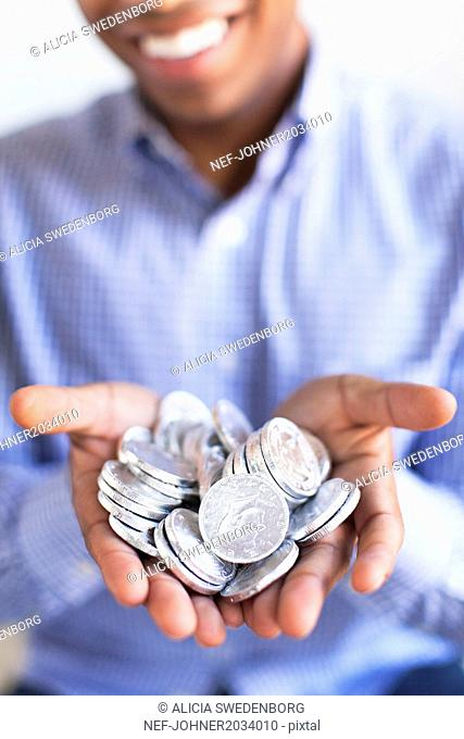 Man holding silver coins