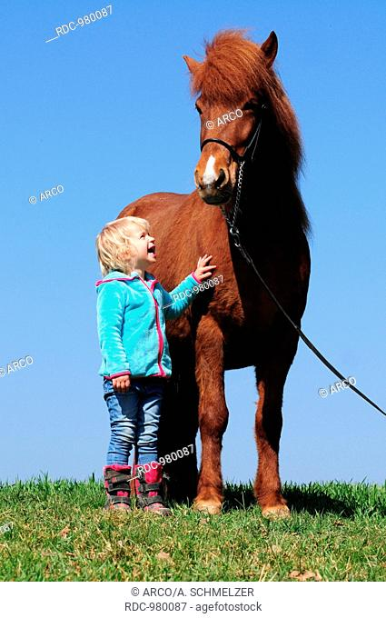 Child with Icelandic Horse, mare, sorrell