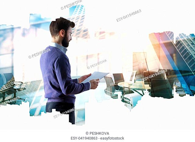 Side view of attractive young businessman reading contract on abstract city meeting room background. Executive and finance concept. Double exposure
