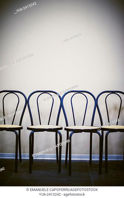Row of chairs against the wall