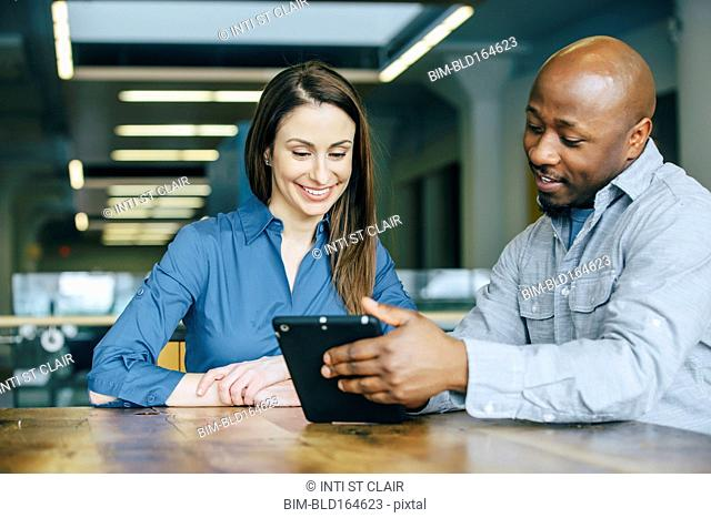 Business people using digital tablet in office