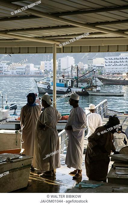Oman, Muscat, Mutrah, Mutrah Fish Market, Men in Traditional Oman robes