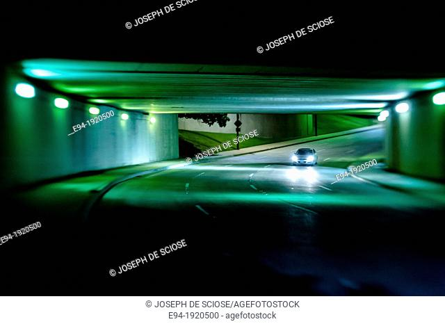 Night time street scene in a road underpass, Dallas, Texas, USA