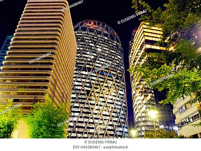 The Paris city at night. Street lights and glass business towers, France