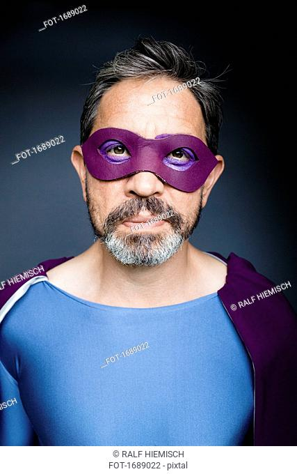 Portrait of superhero against gray background