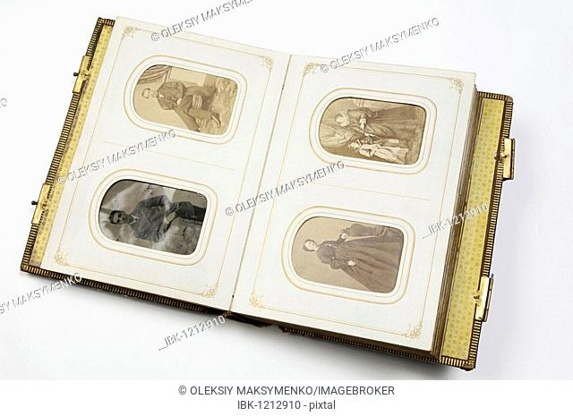 19th century vintage photo album opened on a page with portraits of Victorian American women and men