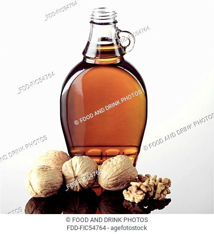 Jar of Maple Syrup with walnuts