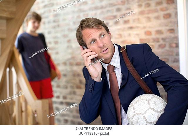 Businessman Father At Home Taking Teenage Son To School