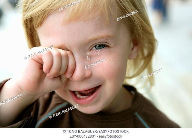 Adorable blond little girl crying closeup portrait