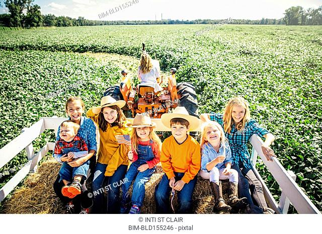 Caucasian family smiling on hay ride