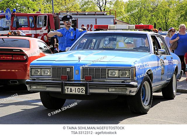 Salo, Finland. May 18, 2019. Oldsmobile City of NY Police Department police car with a man in classic NYPD style uniform. Salon Maisema Cruising, 2019