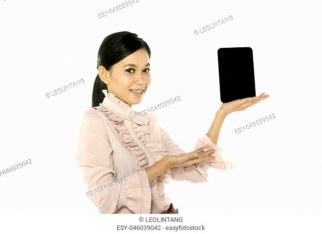 Young asian woman hold touchscreen computer. You can put your message on the pad