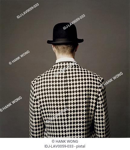 Rear view of a man standing