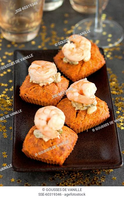 Small carrot cakes topped with shrimps,mayonnaise with capers