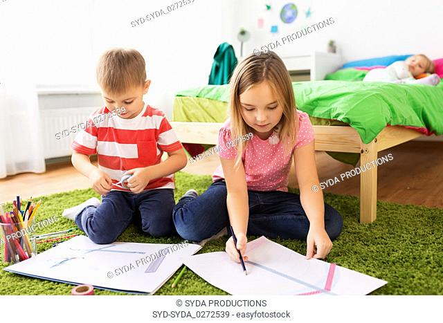 children drawing and making crafts at home