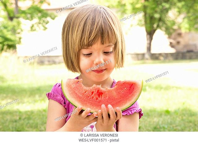 Portrait of little girl with slice of watermelon