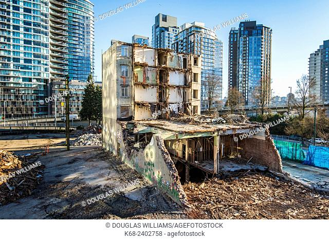 The Continental Hotel at the north end of the Granville St Bridge is going down. Since 1994, it had a mural, Vancouver Island Orcas, by artist Robert Wyland