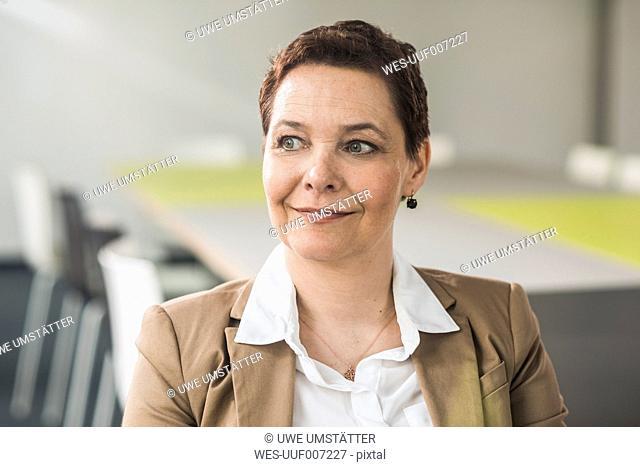Female senior manager sitting in office