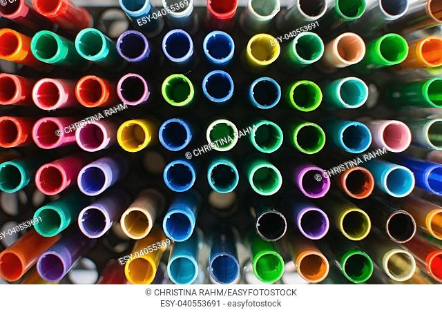 Artists tools coloring pens in many shades seen from above