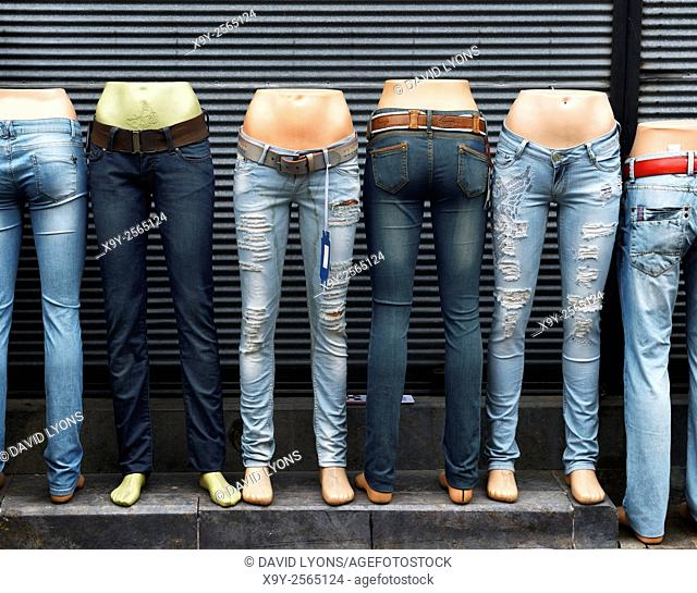 Blue denim jeans pants displayed on mannequin shop outfitters dummies outside tourist boutique in Antalya old town, Turkey