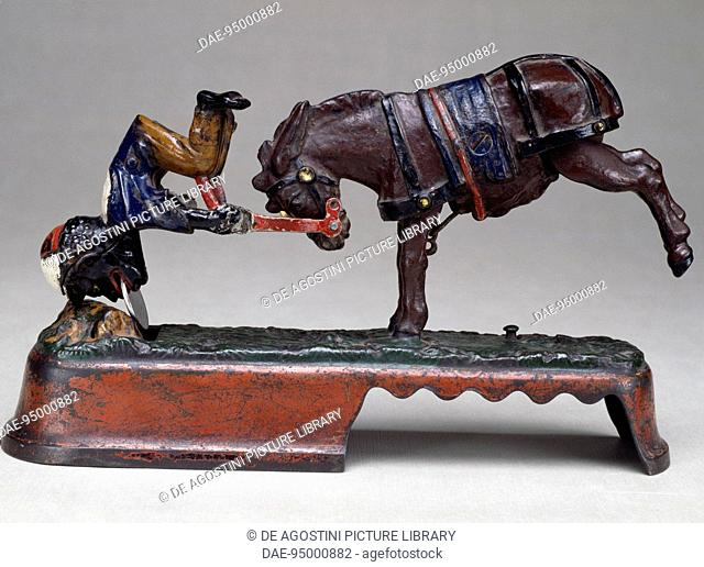 Horse with acrobat, printed cast iron piggy bank. United States of America, 20th century.  Milan, Museo Del Giocattolo E Del Bambino (Toys Museum)