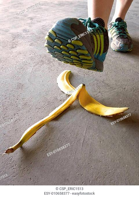 Detail of Person Stepping on Banana Peel and Slipping