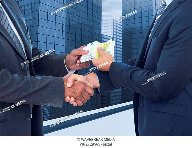Businessmen shaking hands and receiving banknotes