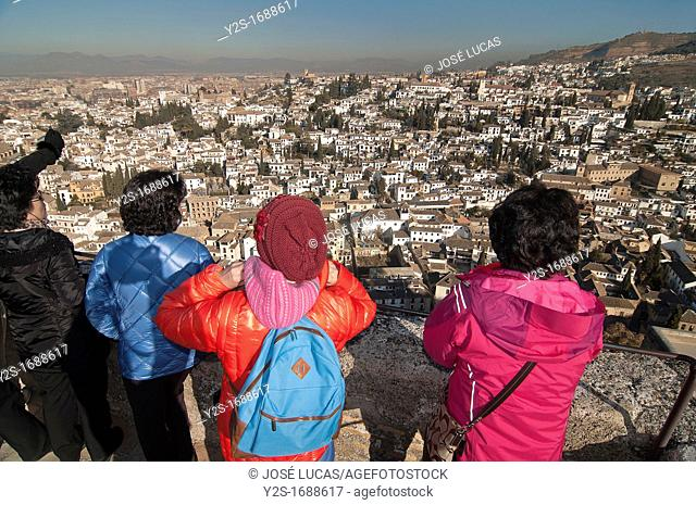 Albaicin district and tourists from the Alhambra fortress, Granada, Spain