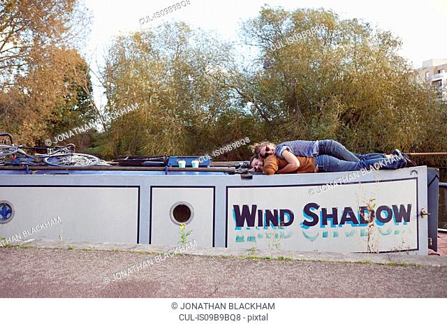 Couple lying on roof of canal boat