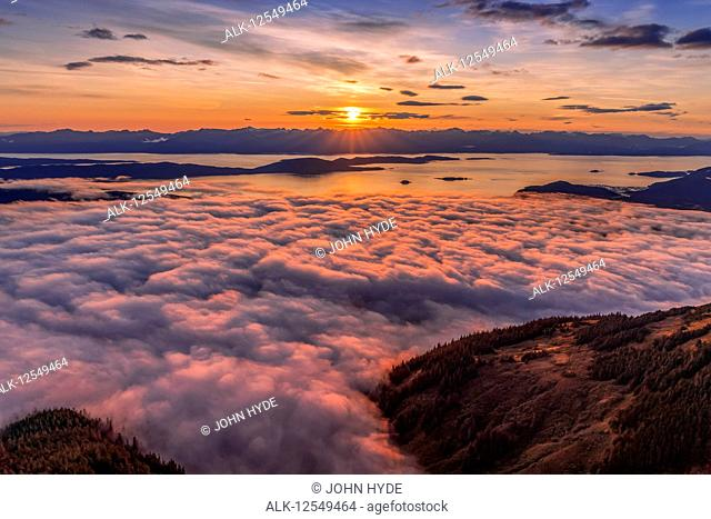 View across Lynn Canal from above Herbert Glacier and Chilkat Mountains at sunset, Southeast Alaska; Alaska, United States of America